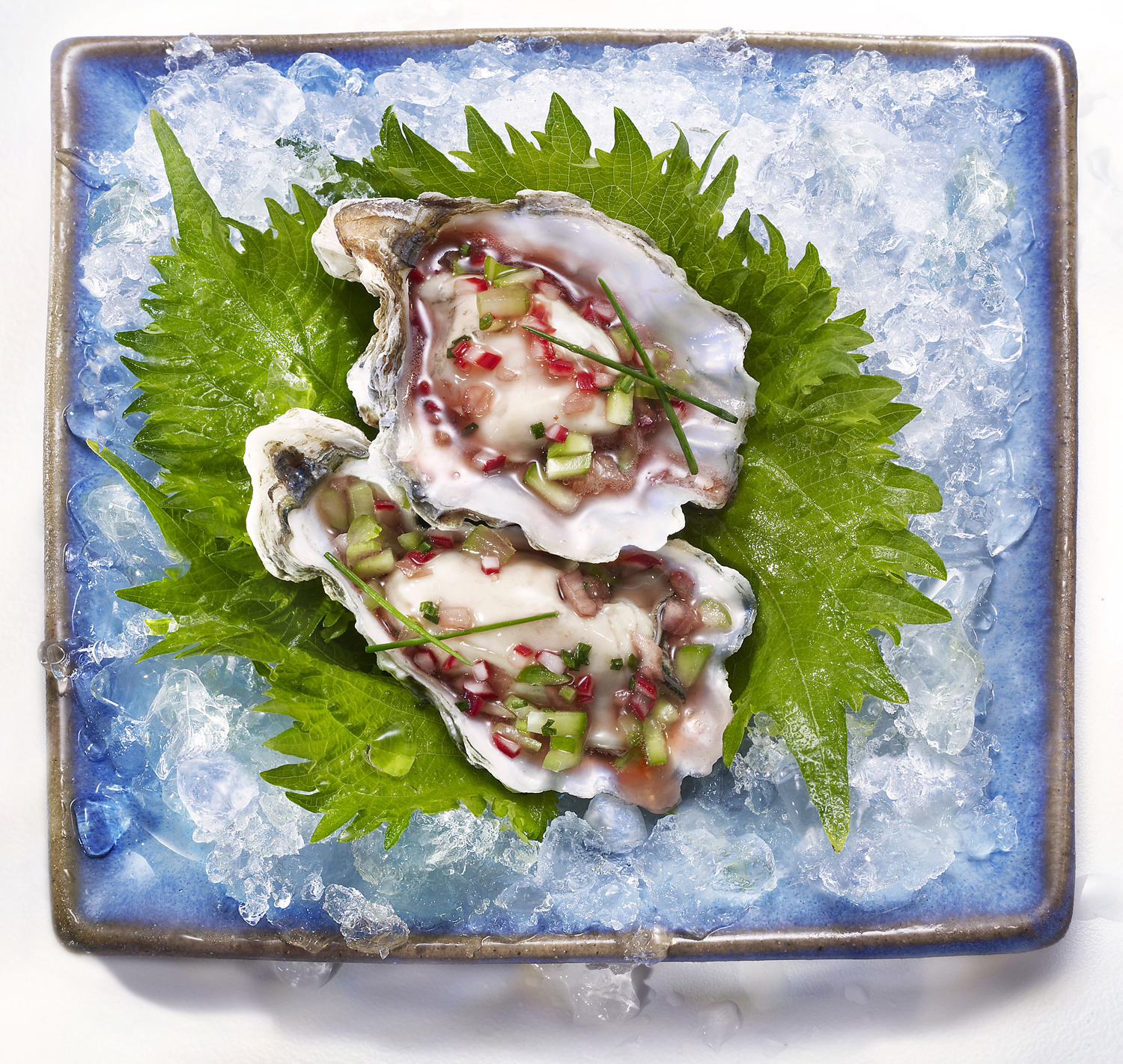 Kumamoto Oysters with Jeweled Vegetable Mignonette on Shiso Leaves