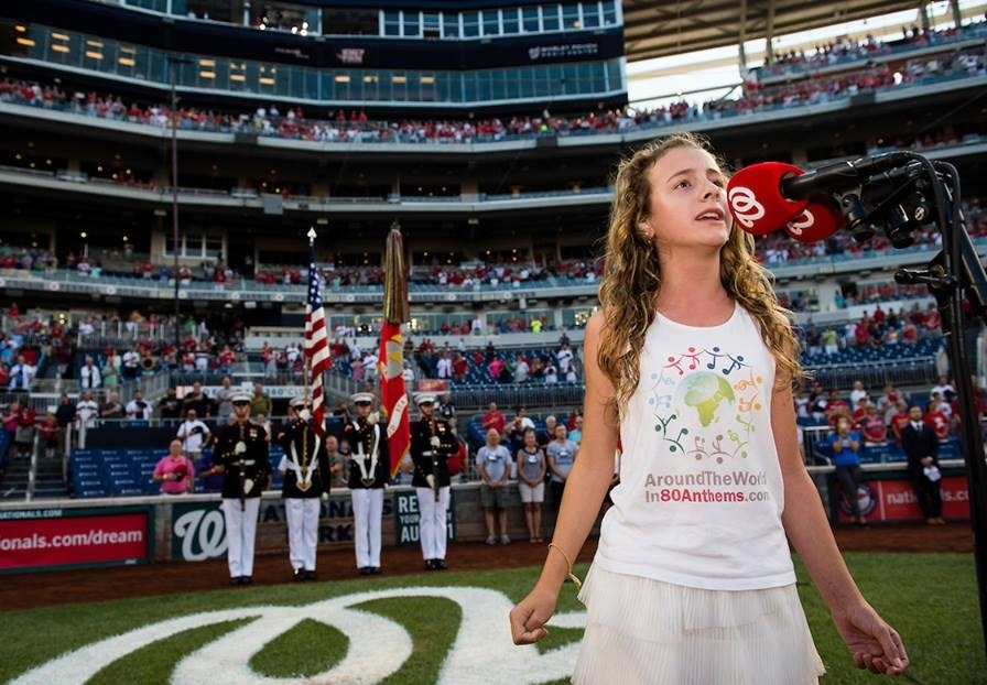 Capri sings her 80th anthem of 80 at the Washington Nationals game.