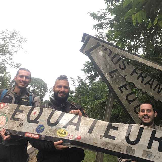 Crossed the equator in Gabon. At first we passed the sign because it had been hit and shattered across the side of the road, so we picked up the remnants and made a new sign! Americans making the world better.