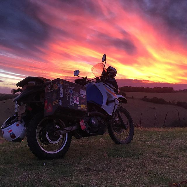 South African sunset and my trusty KLR.  #klr #moto #motorcycle #southafrica #africa #klrsonly #travel #adventure #sunset #mountains #sky
