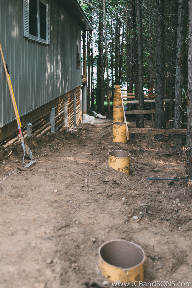 """We built this new covered porch on this cottage to allow access from the front of the cottage to the back deck overlooking Townsend Lake. The foundation piers were created using BF20 Bigfoots with 10"""" quick-tubes installed 4'-0"""" below grade to ensure adequate frost protection."""