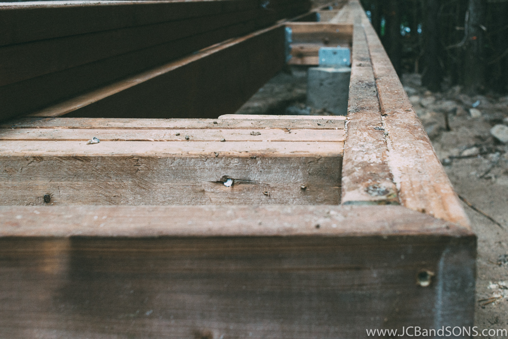 Deck building is a form of trim carpentry so all corners are mitered even on the framing.