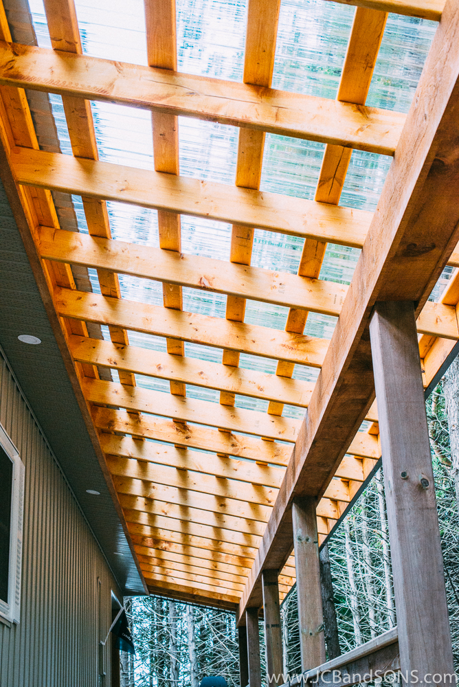 The wooden structural beam was clad in pine barn board and finished with a coat of Sikkens Cedar Stain.