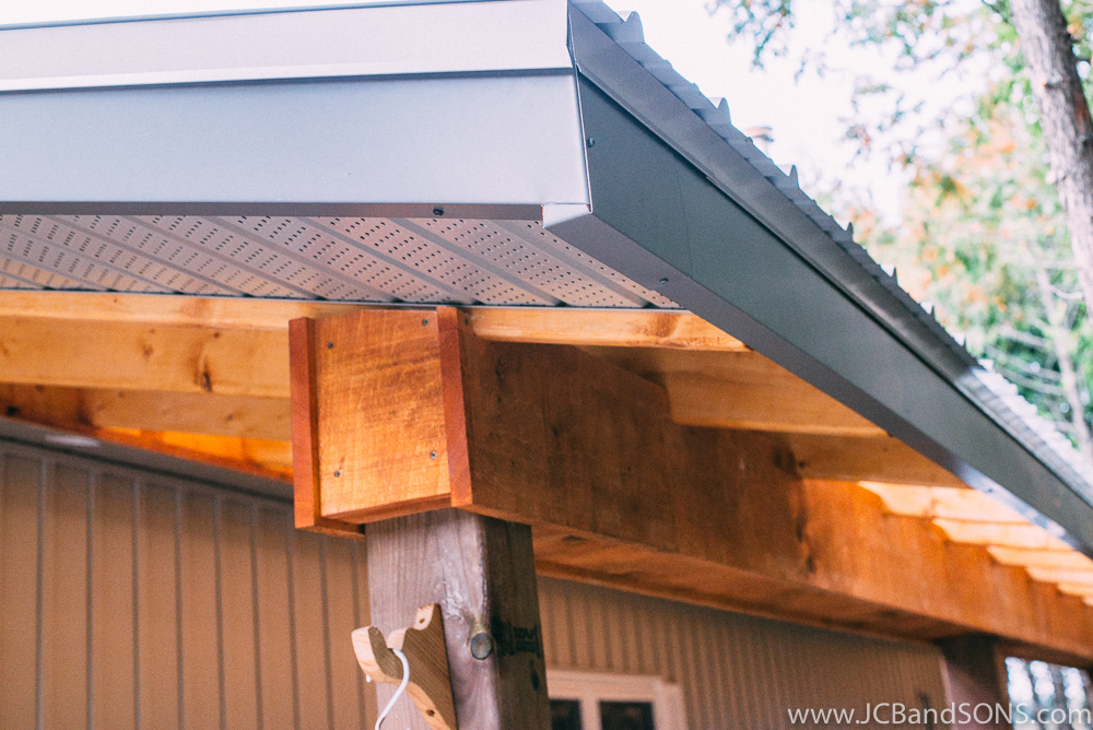 We installed new vented soffit on the ends to tie neatly into the home and clad all the fascia boards in aluminum fascia we custom bent on site.