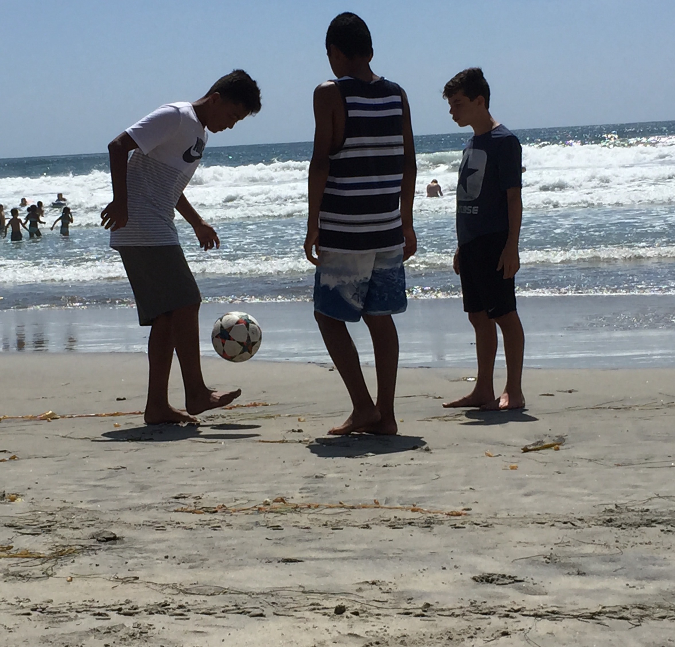 Desmond Wendt (on the right) juggling the ball with his friends on a beach in San Diego. Looks to me like they're doing just fine.  Photo by Dennie Wendt