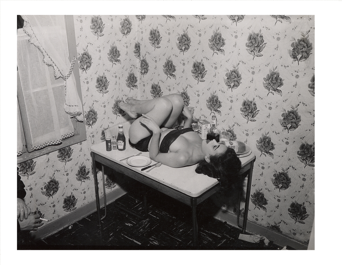 In this odd and kinky fetish photograph, the man's hands in the bottom of the left corner signify everything. c. 1950.