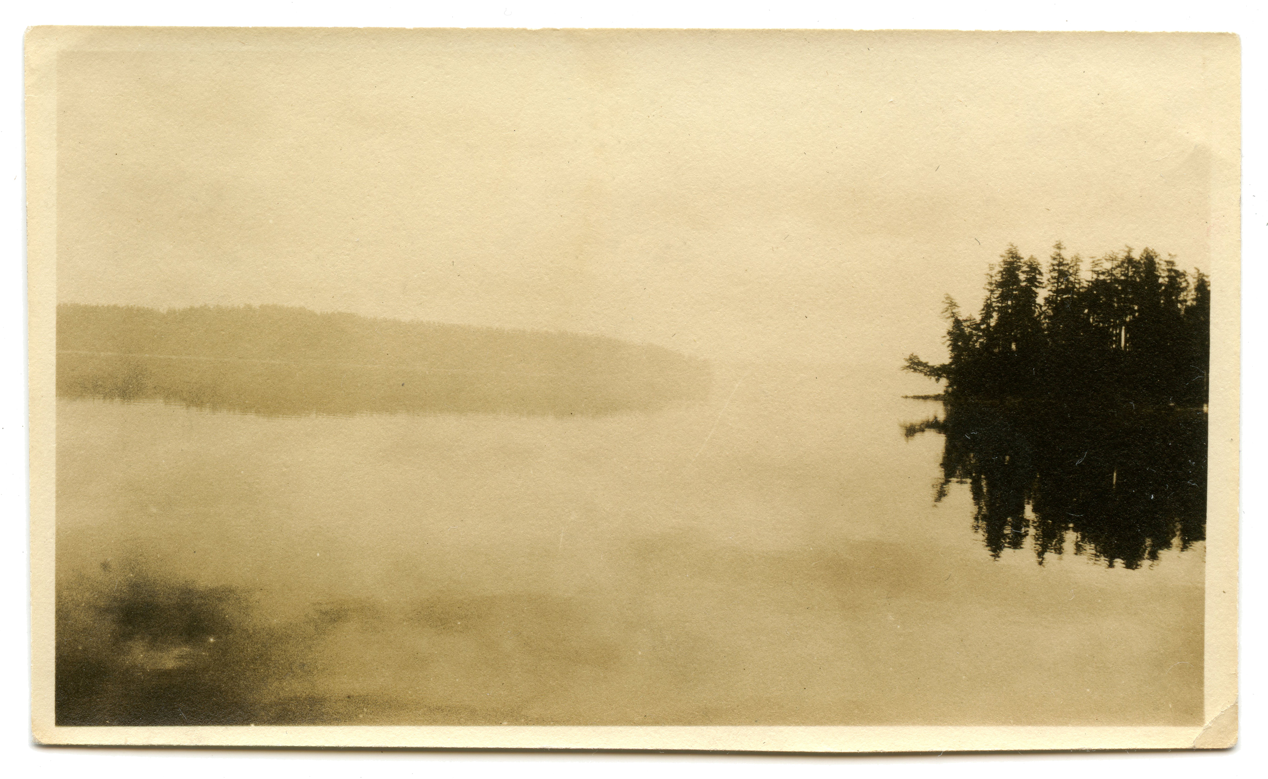 This photograph of a misty lake in the late 1930s reminds me of the American abstract painter Adolph Gottlieb (1903 - 1974).