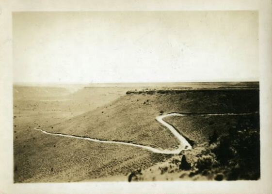 Winding road snaking through the American West. c. 1920