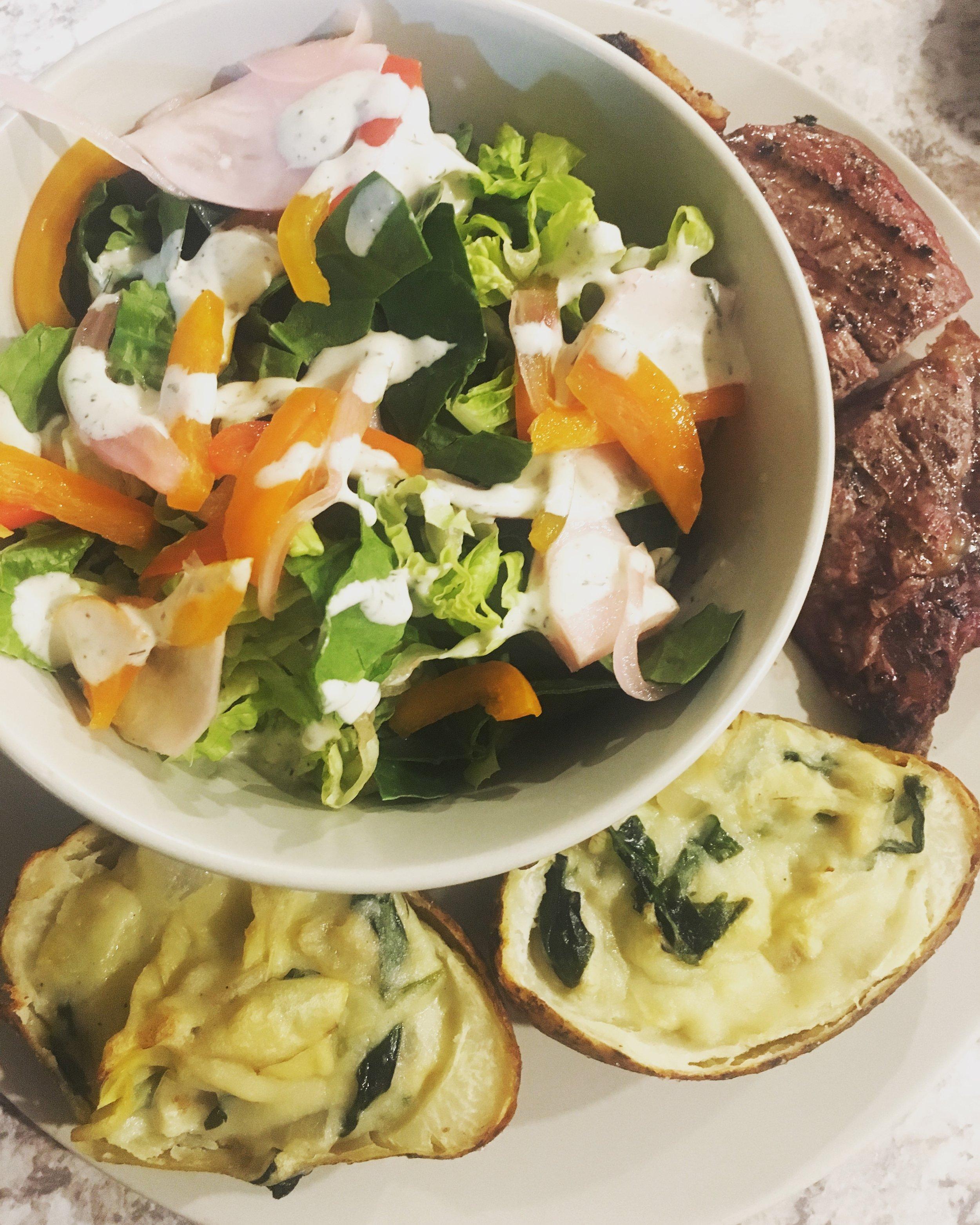 garden salad, grassfed ribeye steak, twice baked spinach artichoke potatoes