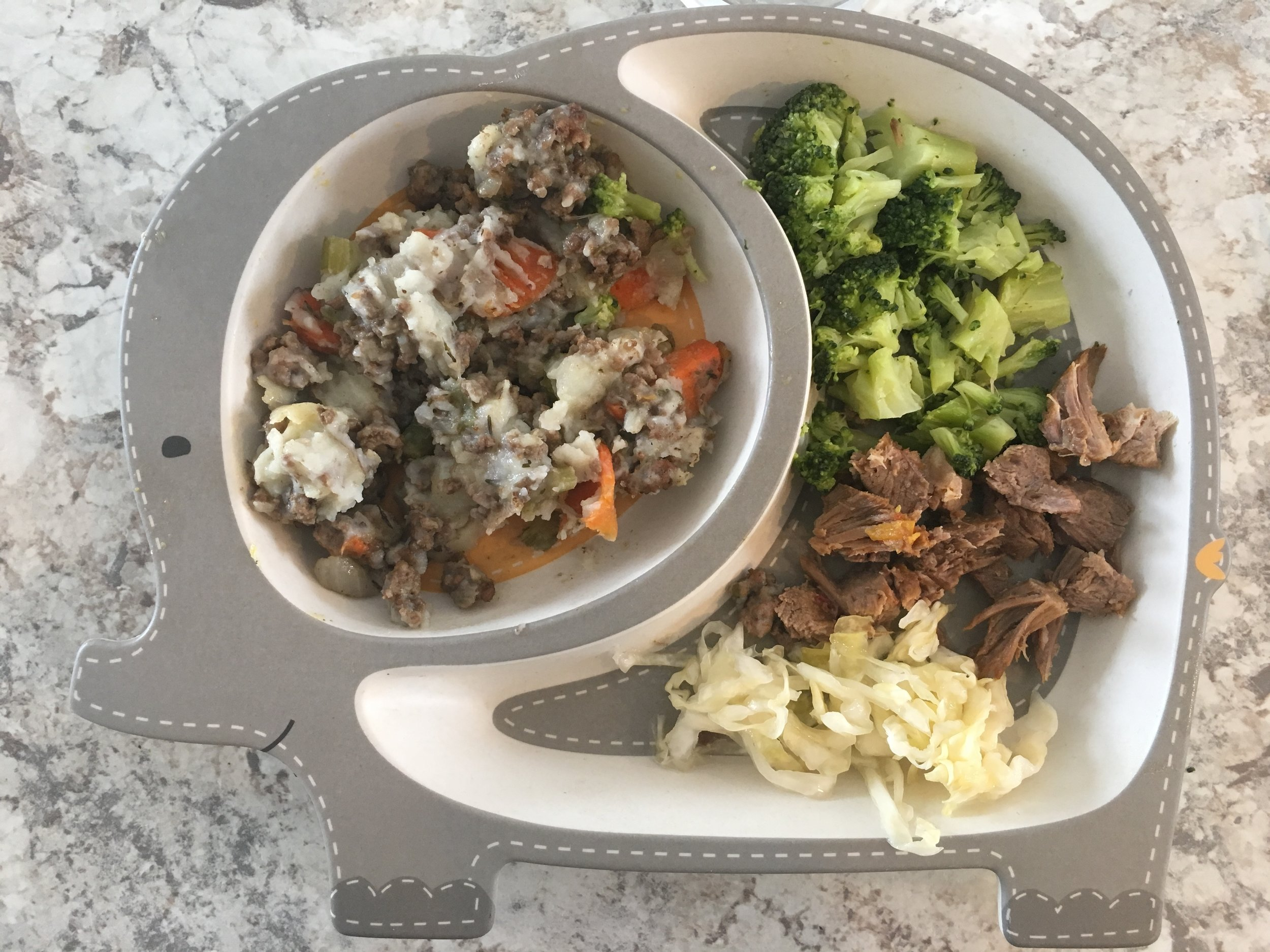 Shepherd's pie, broccoli, sauerkraut, and a little roast