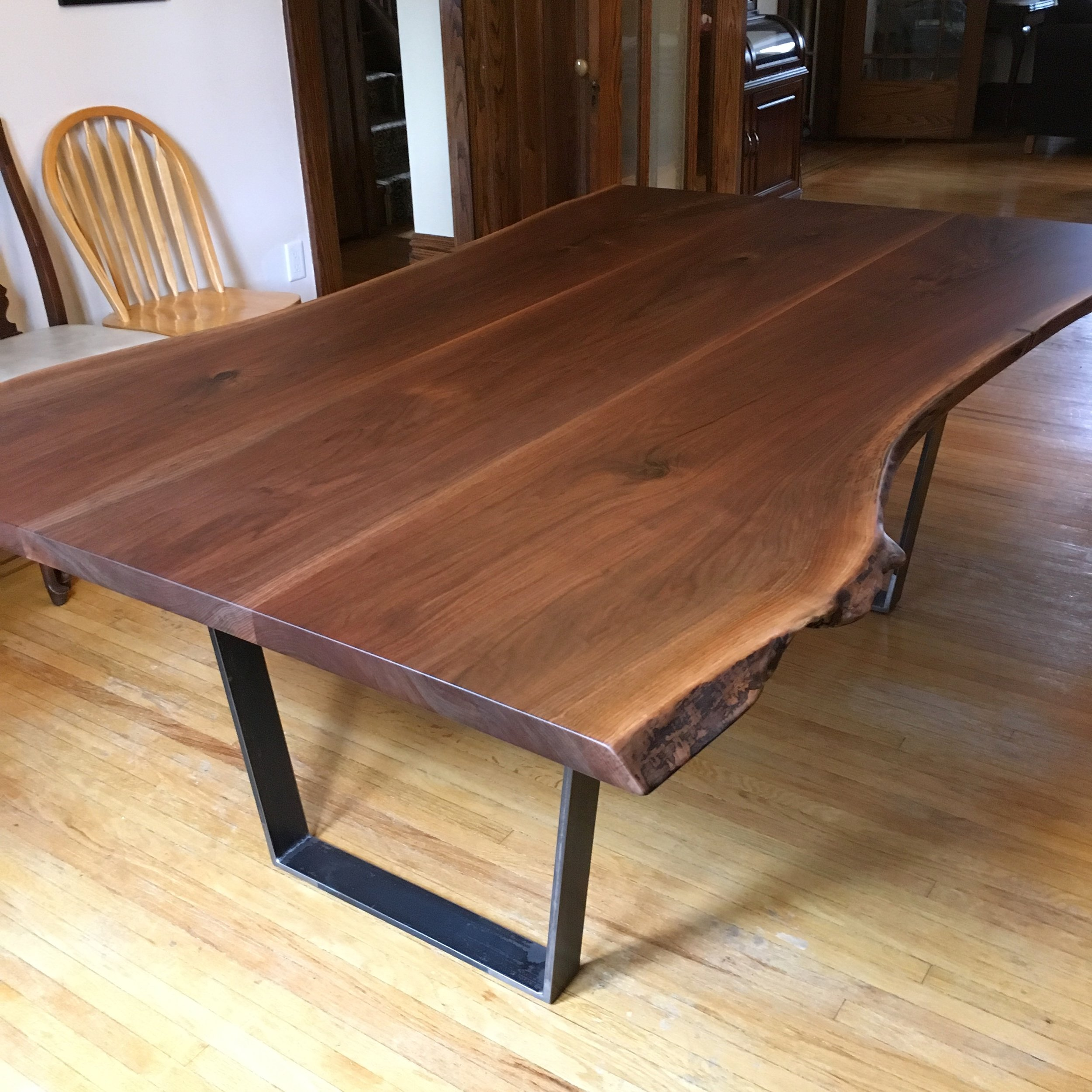 Live edge walnut top with trapezoid base