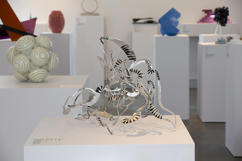 collapse , 2018. Finalist, Deakin Small Sculpture Award. Hand folded, laser cut aluminium, ink. 53 x 70 x 30cm