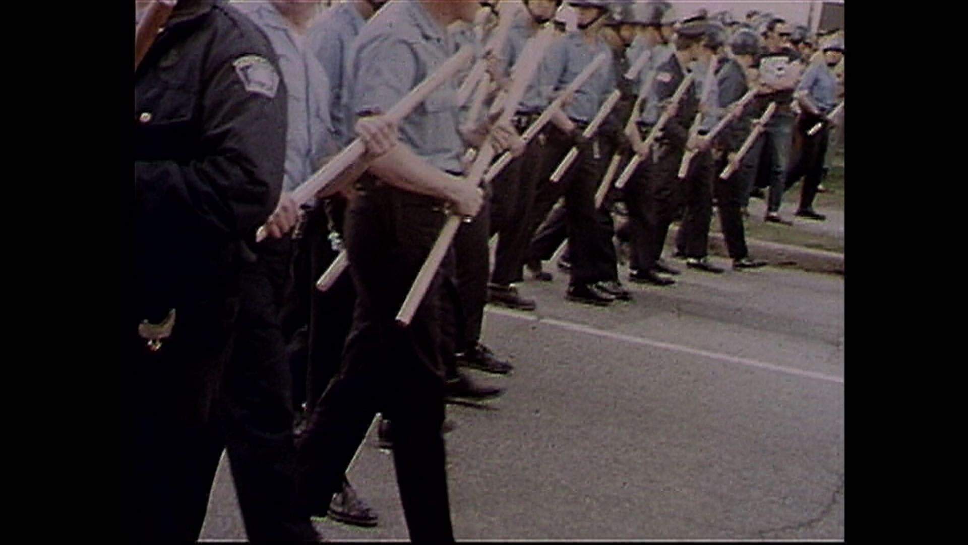 Red Barn Protest - Cops marching down Oak St..jpg