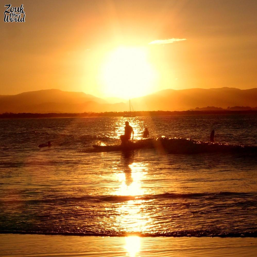 Surfers in Byron Bay