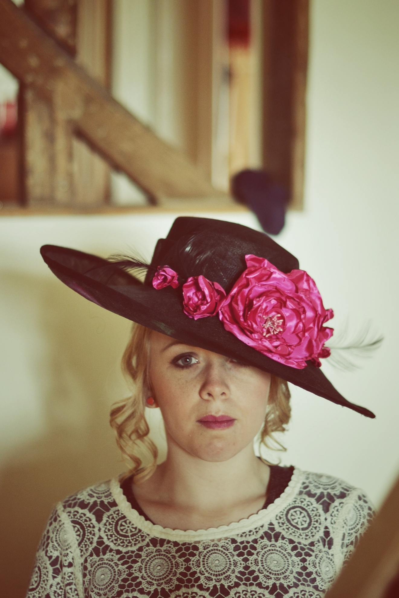 Wide brimmed hat with handmade peony