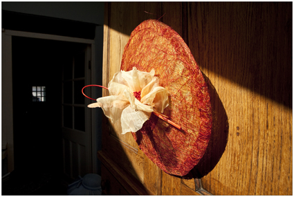 Large oval saucer hat with handmade poppy