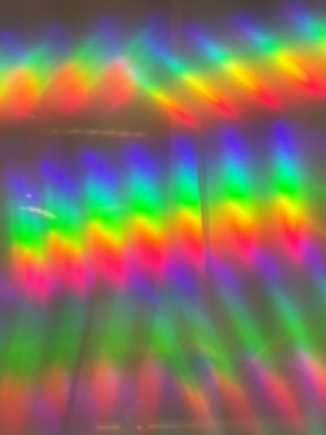 A photo taken through diffraction grating shows the two ends of the spectrum overlapping. Magenta appears when red light blends with blue light.