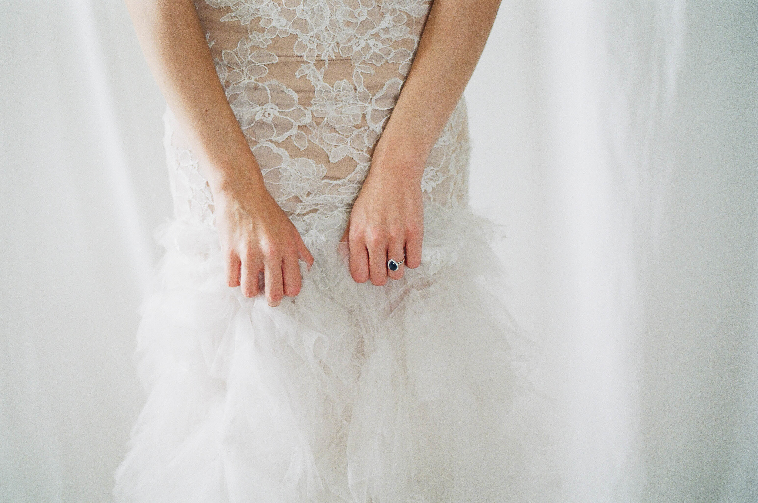 wedding ring and lace wedding dress