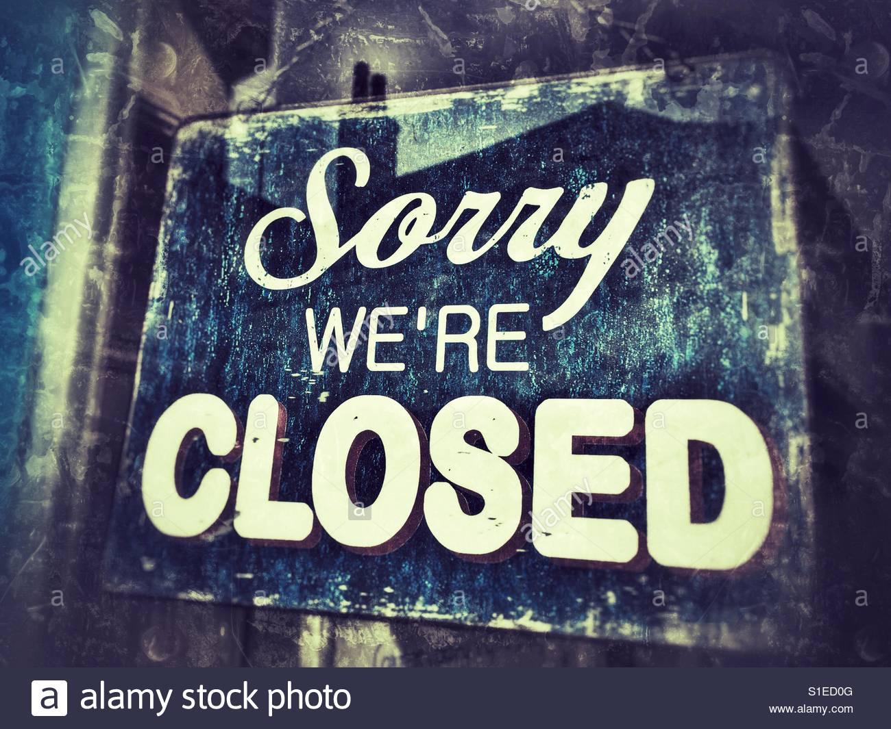 sorry-were-closed-sign-in-shop-door-window-S1ED0G.jpg