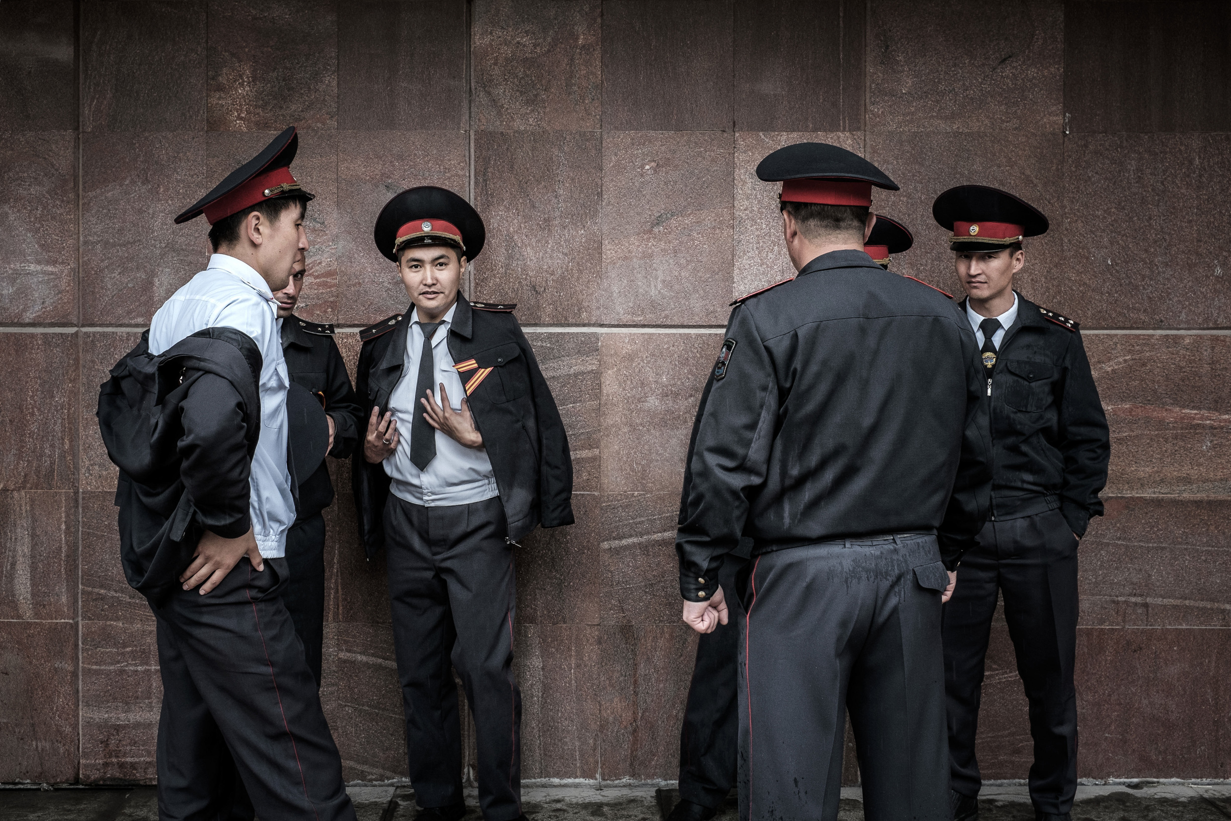 Police officers having chat after the military parade. Bishkek, Ala-too square, May 9, 2015