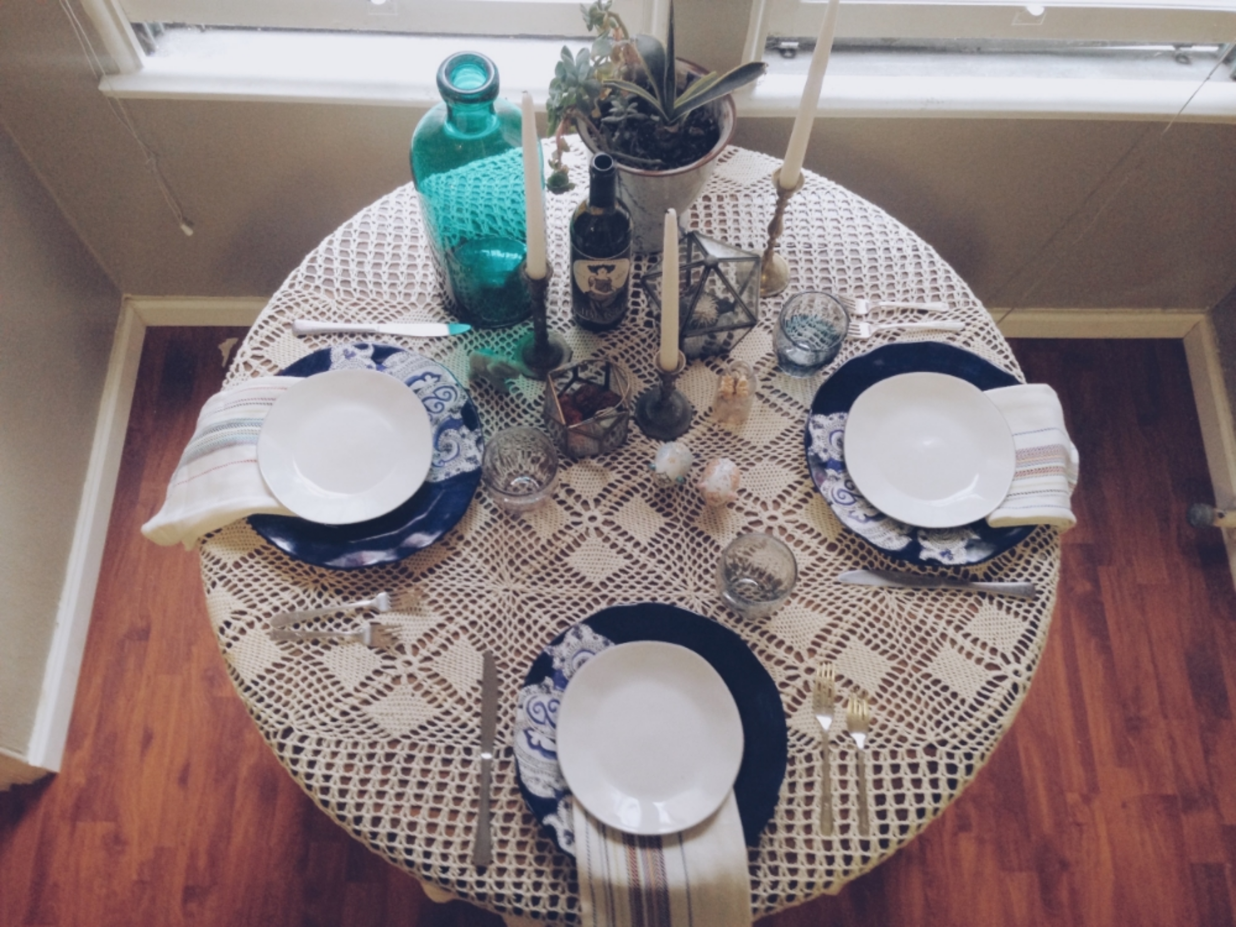 Tip: Use varying heights such as candlesticks, terrariums, and wine bottles to add depth and interest on the table