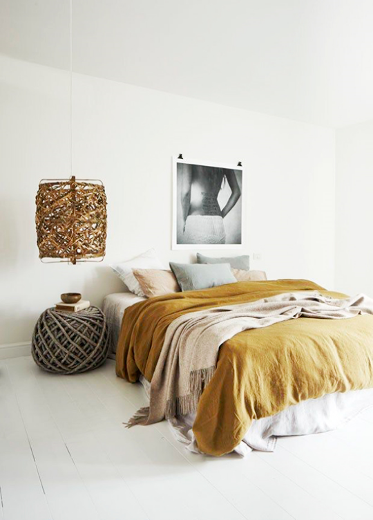 I love this pop of large art on the wall. A large art piece speaks volumes, you don't need much more. Be sure to keep the artwork balanced. If it's a colorful piece, neutralize the bedding and vice versa.