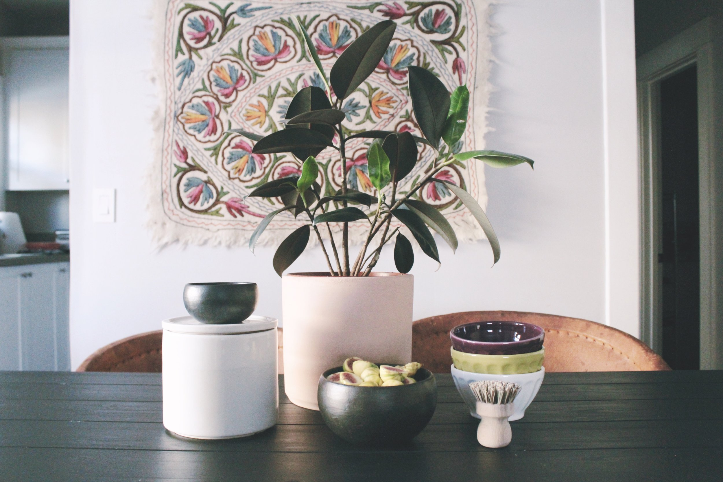 Photo c/o Found + Kept   R to L   Vintage Ceramic Coffee Canister   Peacock + Co Planter   Anthropologie Black Pasta Bowls   Anthropologie Latte Bowls  
