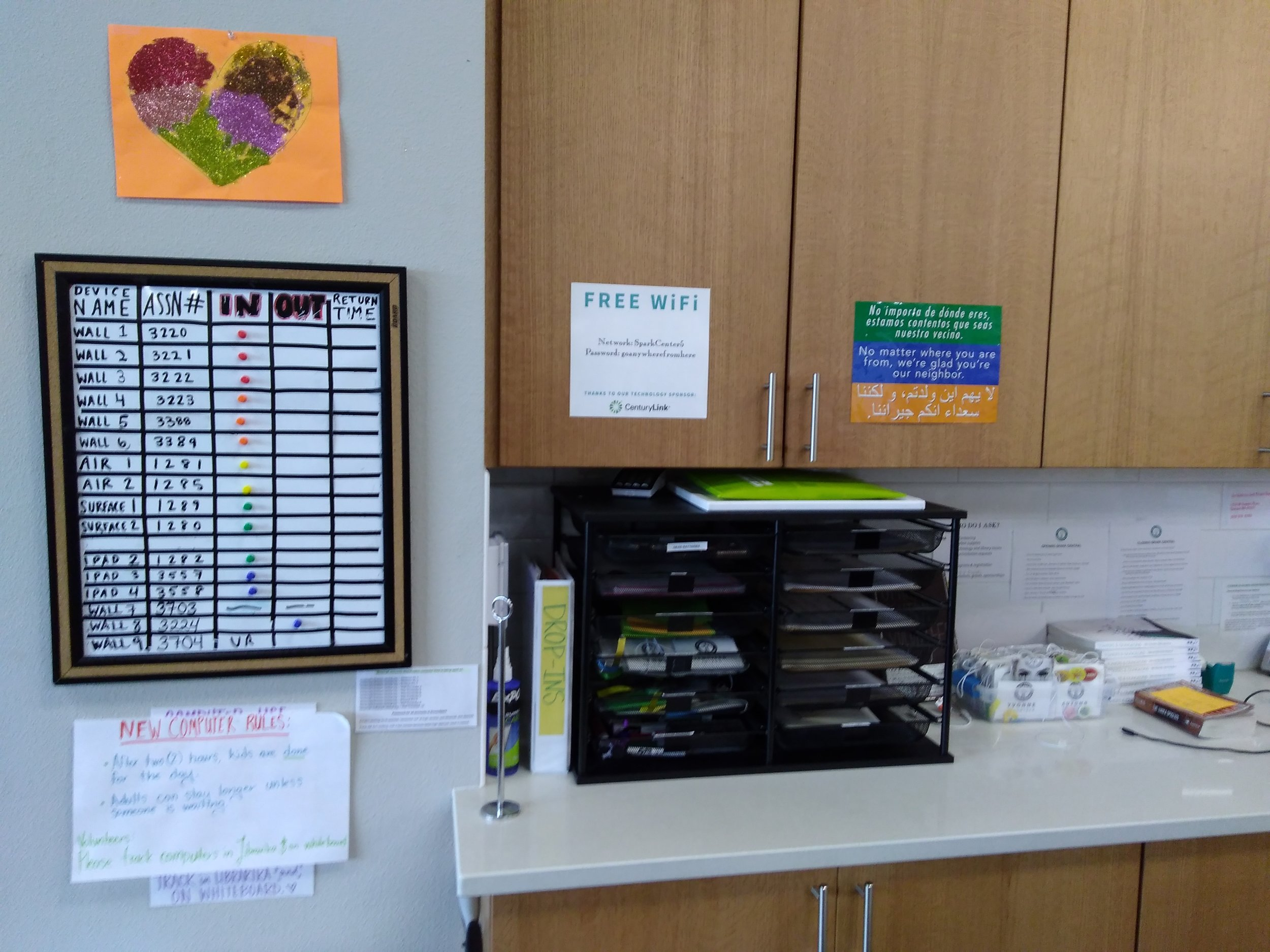 Back Counter - Completed membership forms are located in the file basket on the back counter, while printer paper, envelopes, VR head gear and accessories, bicycle locks, and office supplies are in the back cupboards.