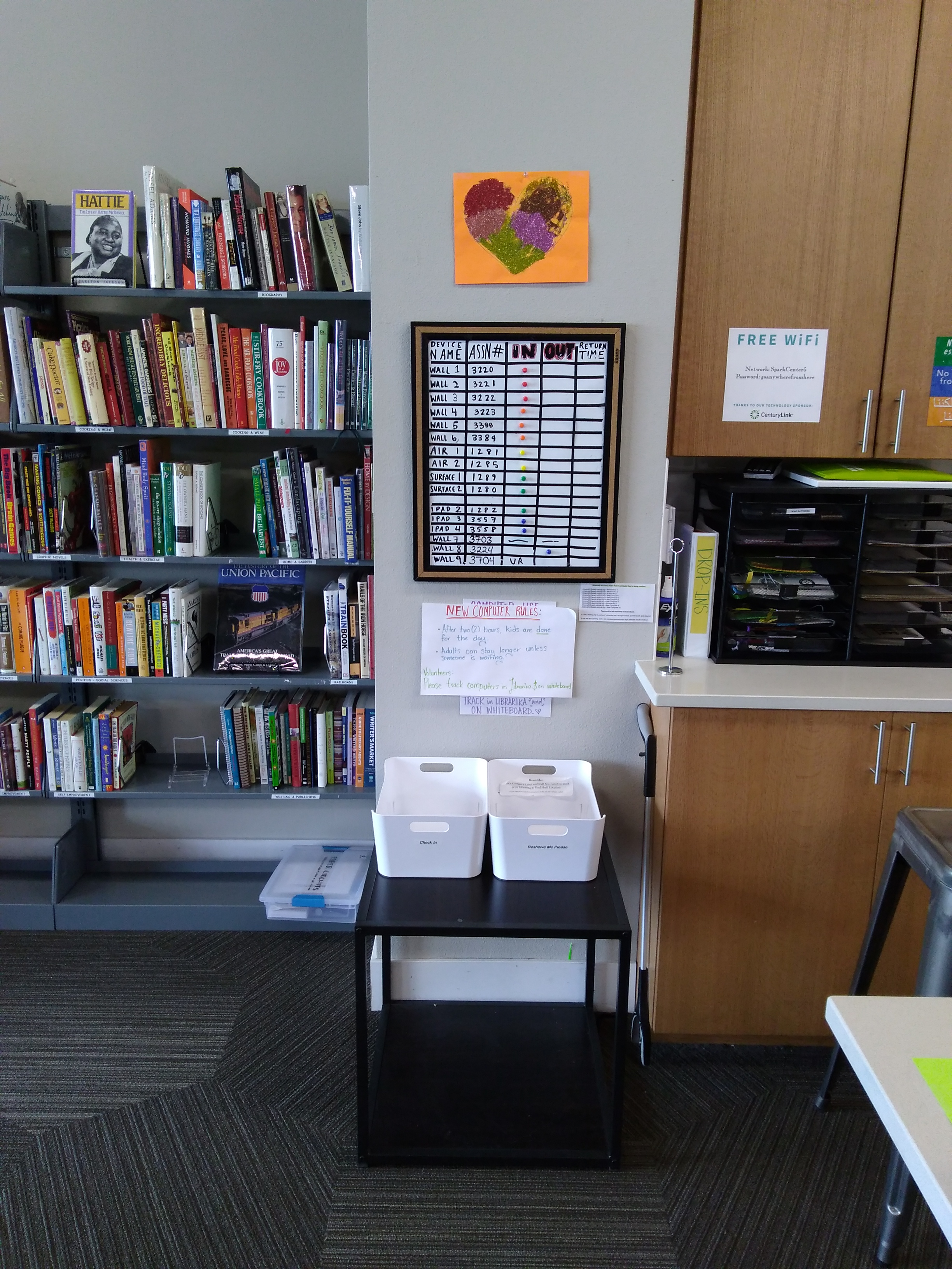 Sign Out Board - A sign out board on the back wall records which computers, tablets and laptops are in use.*See Computer Sign-out Procedure for detailsA new cabinet, located below the sign-out board, holds laptops and surface pro tablets. Baskets for library resources that need to be checked in or filed are also located here.