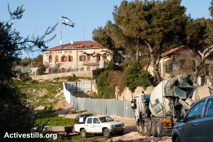 Construction expands the Israeli settlement Beit Orot in the Al Tur neighborhood of East Jerusalem, February 28, 2011. Unilaterally annexed by Israel after the War of 1967, East Jerusalem, including the Old City, are still considered occupied Palestinian territory under international law. (photo: Ryan Rodrick Beiler/Activestills.org)
