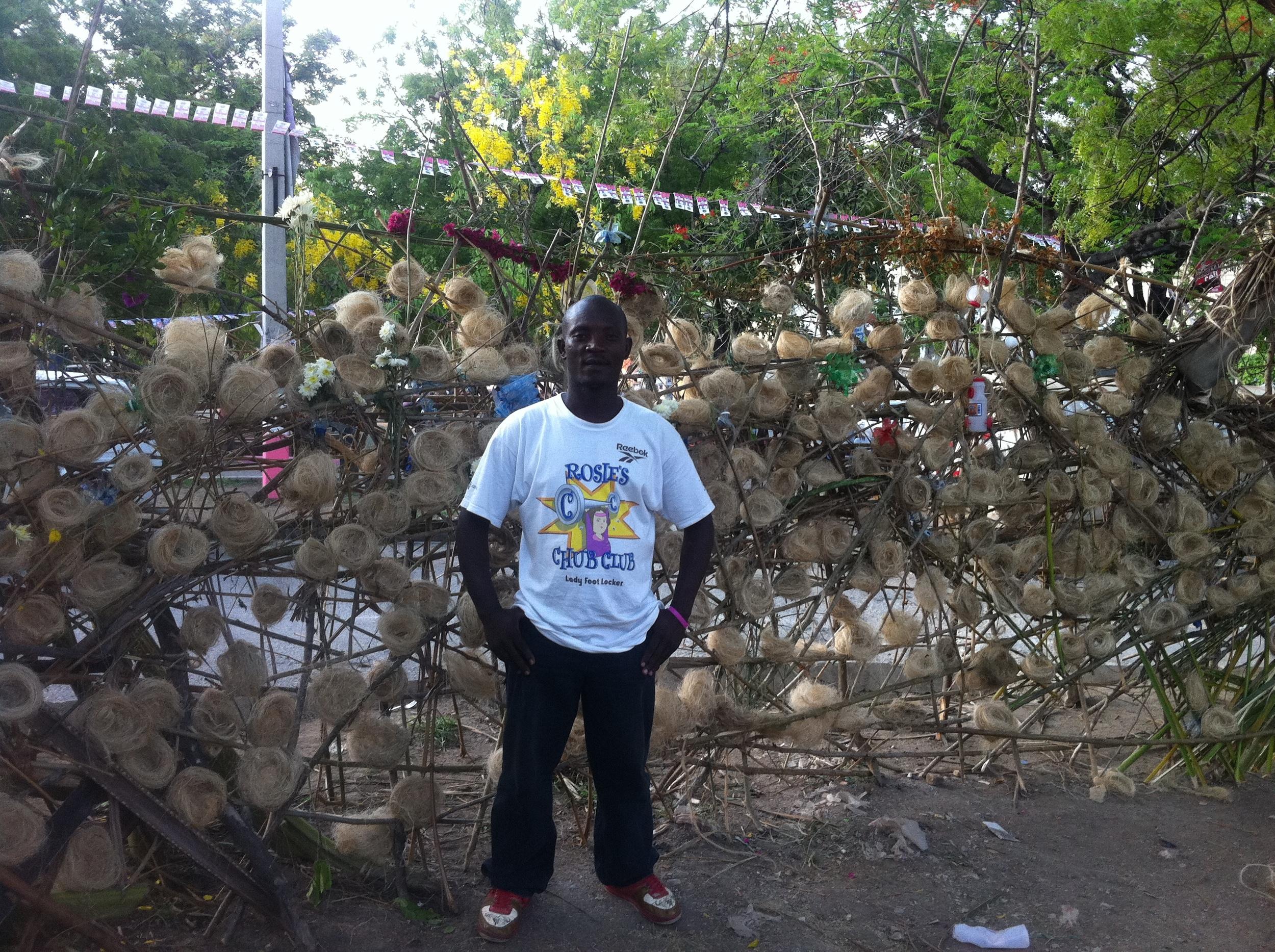 team leader in front of hundreds of memorials