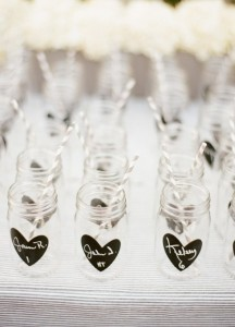 Use    mason jars as escort cards. These could also double as  favors too! Just paint a shape on the jars using chalkboard paint and have your guests write their names. Everyone will love them and it's something the guest could use again.