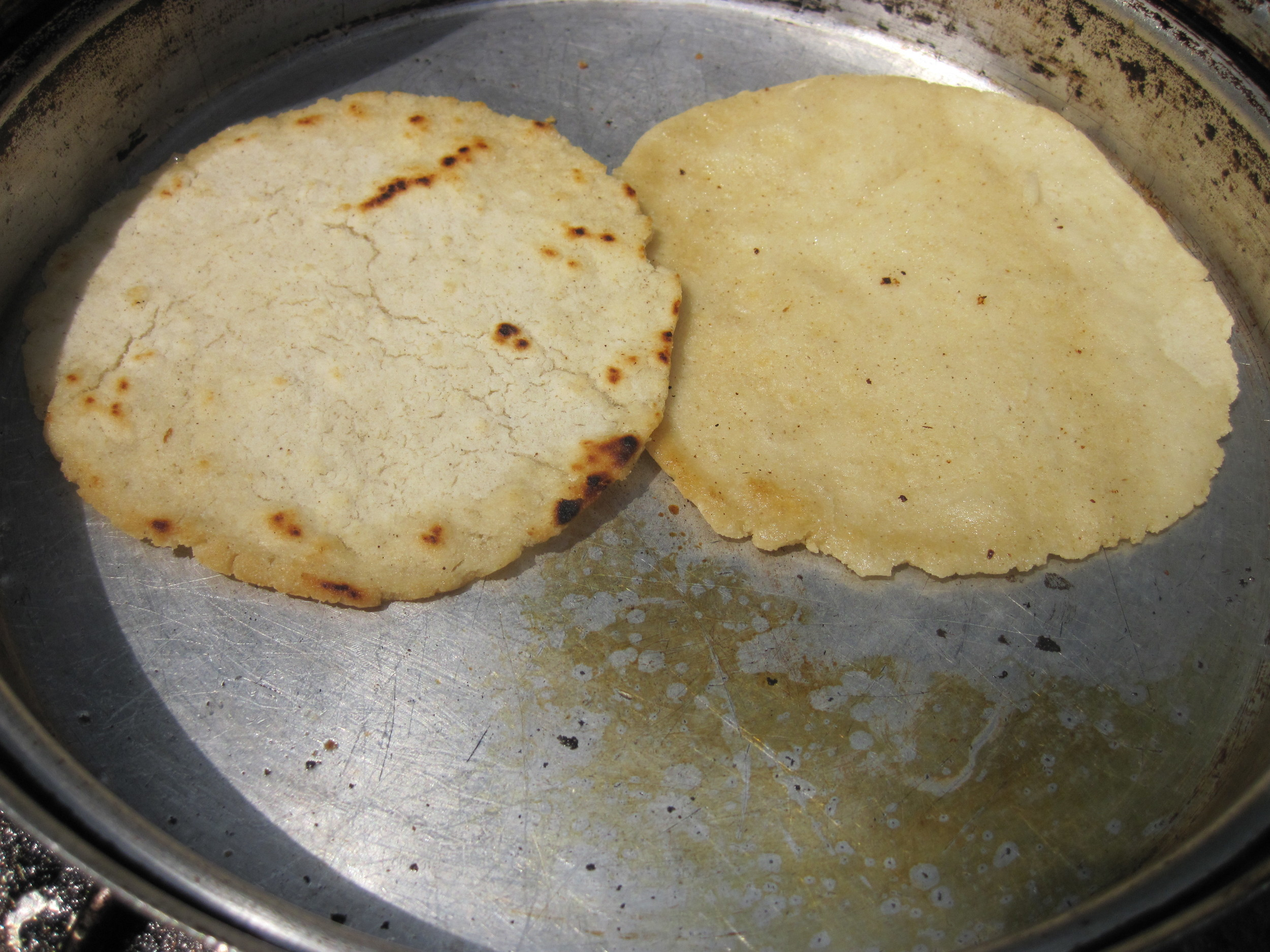 Fresh tortillas cooking on the camp stove.