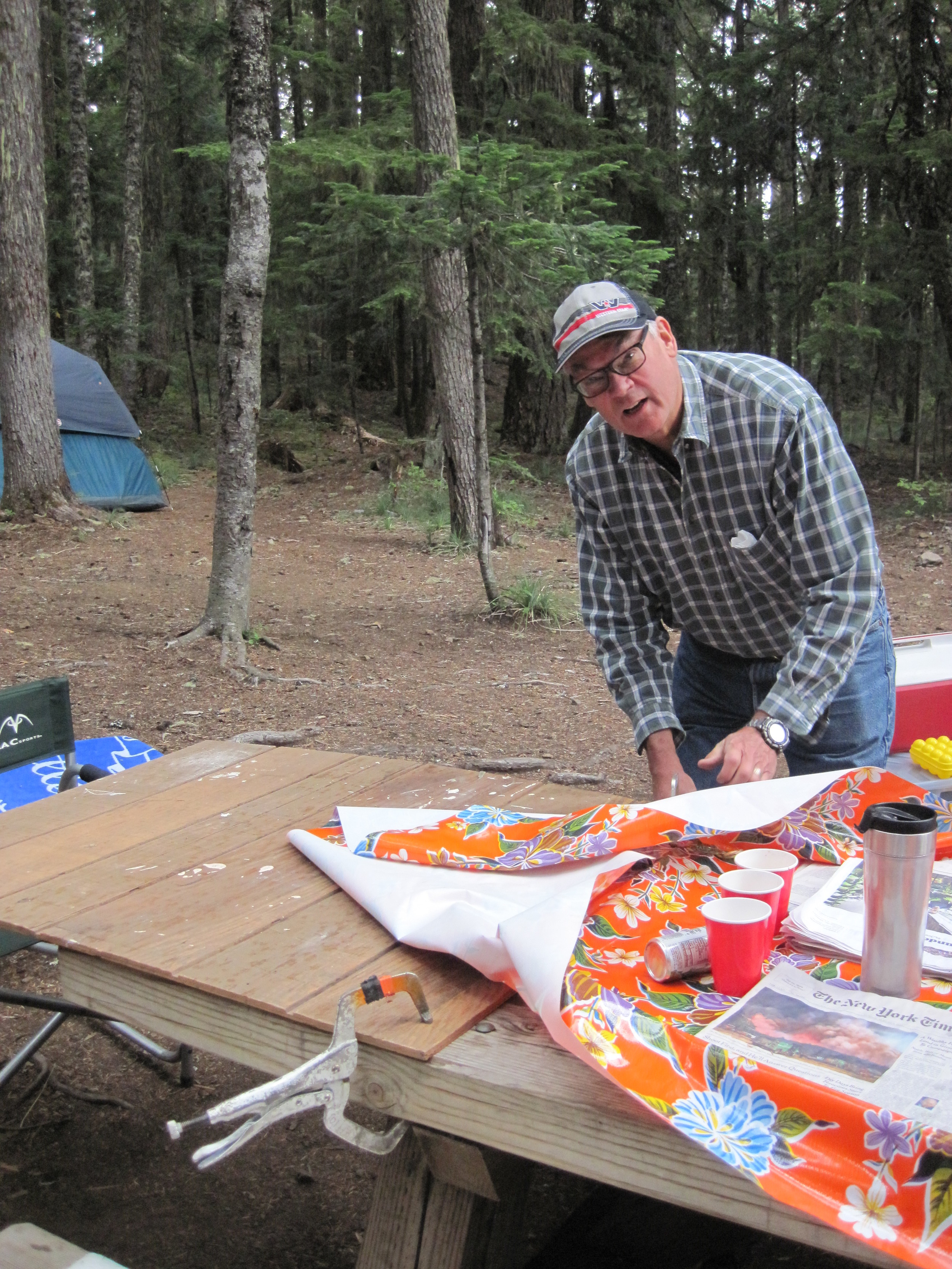 """My uncle attaching a """"leaf"""" to our picnic table so that more people could sit there."""