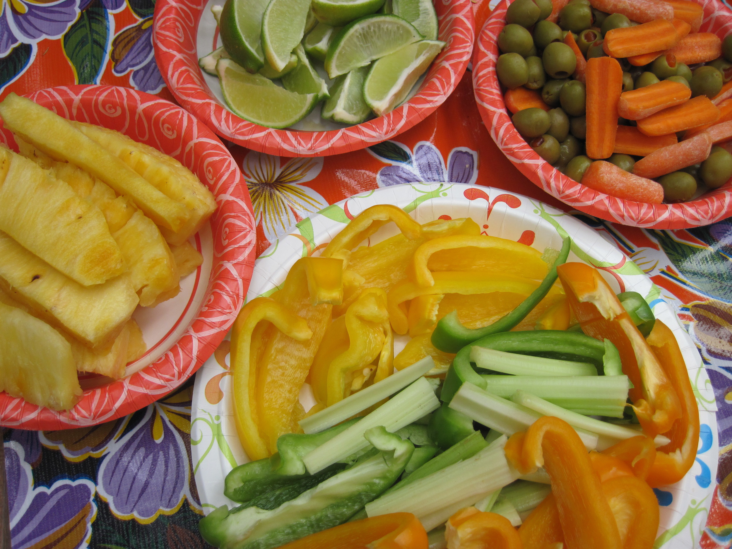 Fresh pineapple and an assortment of veggies & lime slices for the tacos.