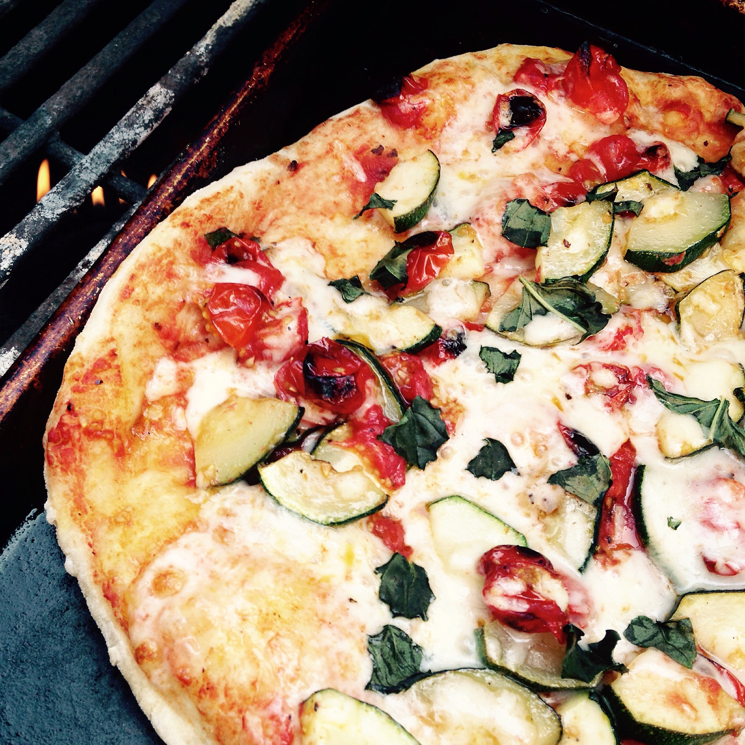 homemade zucchini tomato basil pizza on the grill
