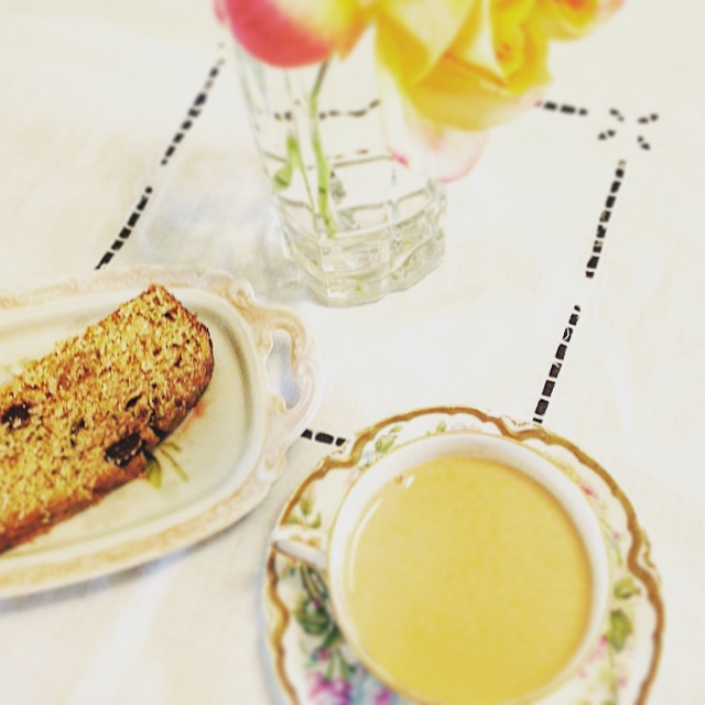 A fresh slice of mint chip zucchini bread with a lovely cup of tea.