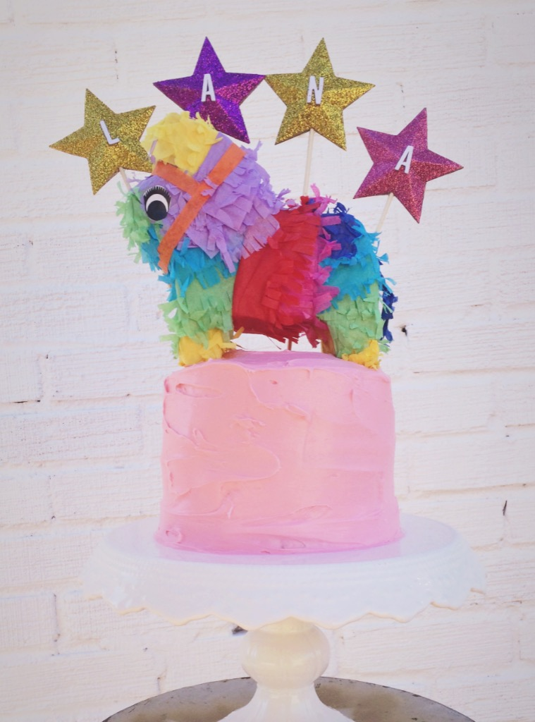 For Lana's 1st birthday fiesta, I created these sparkling stars and we purchased the mini-piñata as the final statement piece.