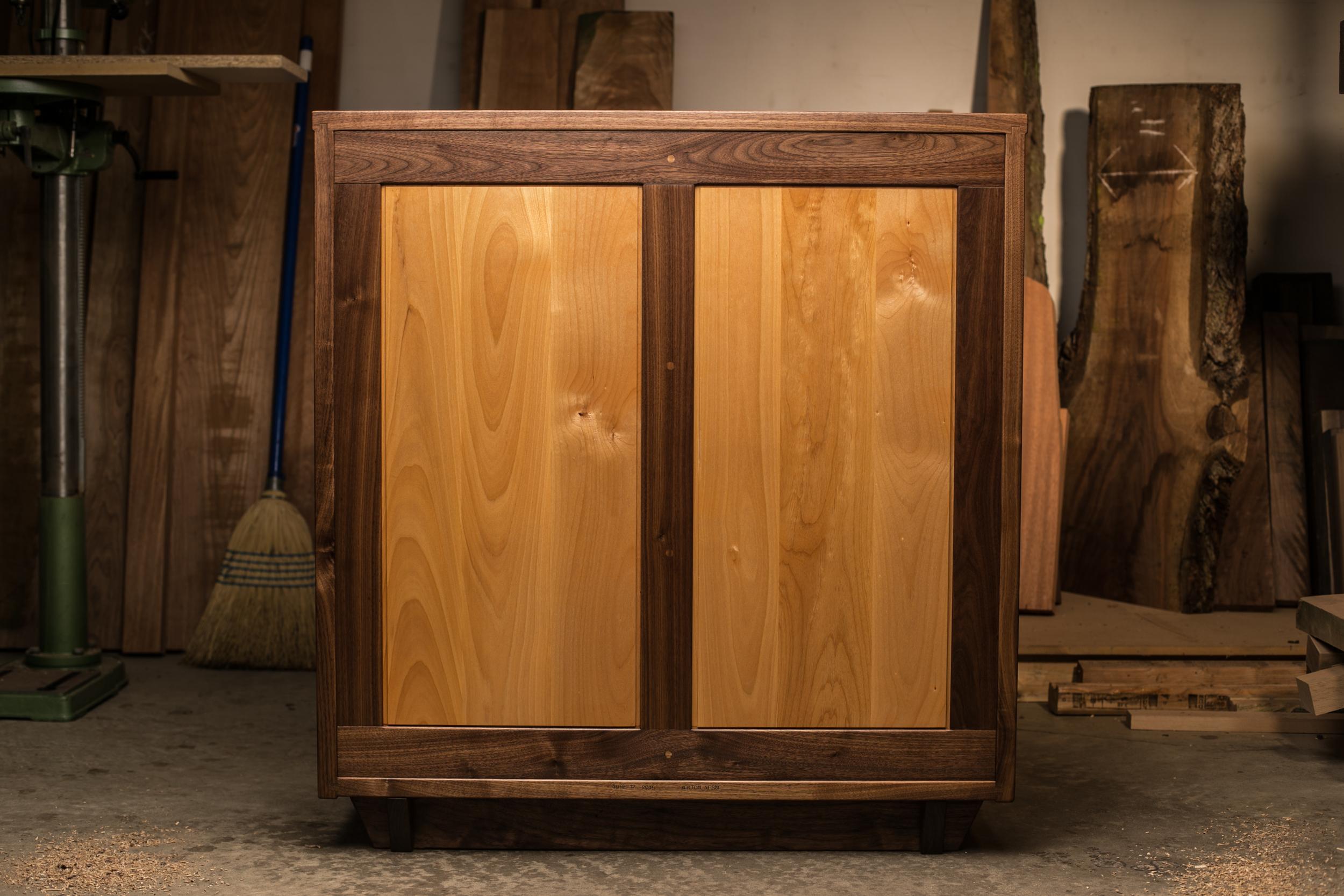 Back: frame & panel solid back. Walnut frame with Alder panels