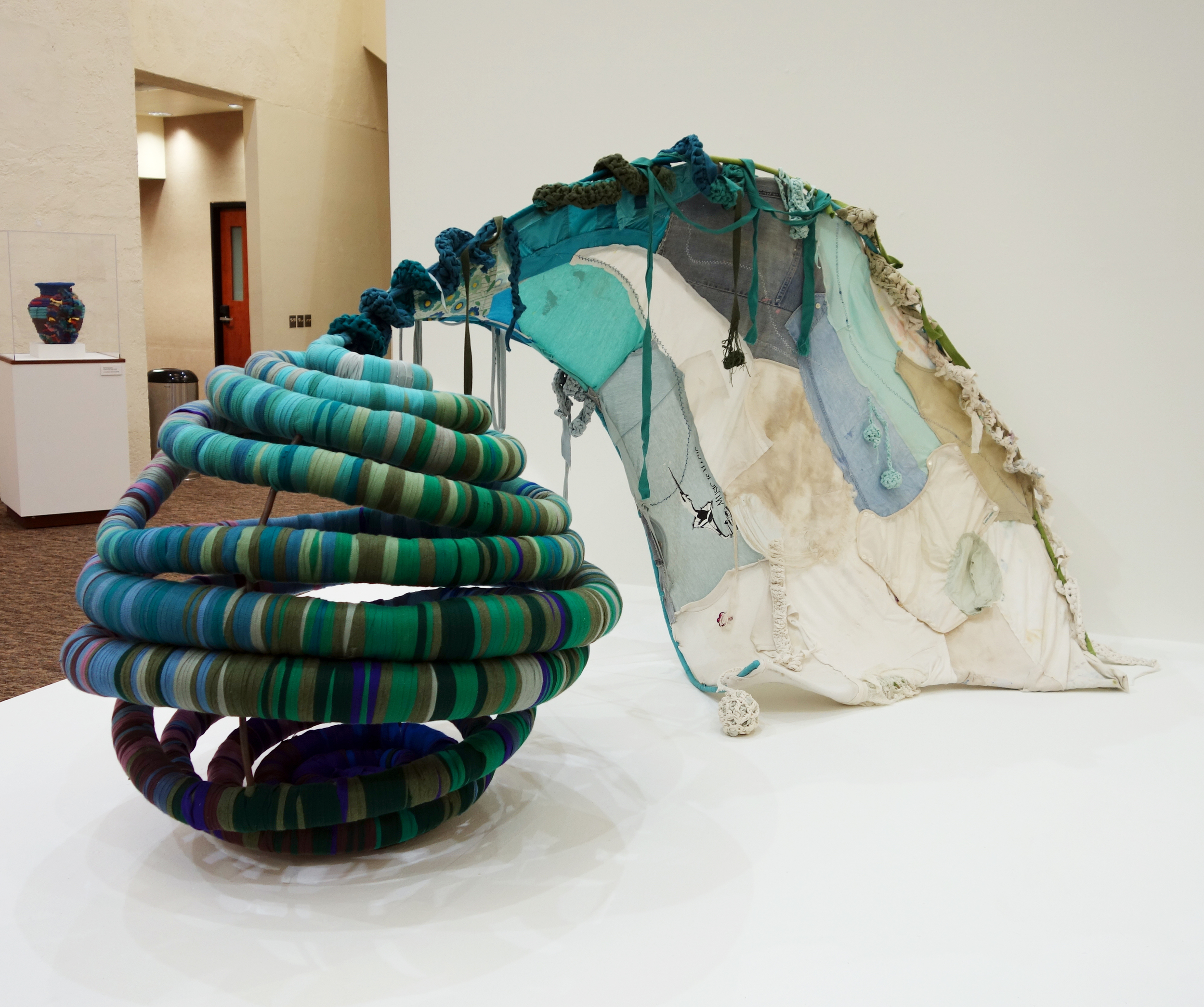 "she sailed in a boat who's wing was sometimes a tail   42 x 60 x 36""  Sunbrella®, pool noodles, steel rod, used clothes  Pictured here in   11 Miles of Color: Repurposing Spring Crossing    at the  Gallery@The Library , Scottsdale Civic Center, 2016"