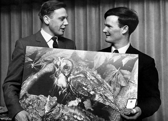 C.V.R. Dowdeswell (right) accepts inaugural Wildlife Photographer of the Year Award from David Attenborough in 1965.
