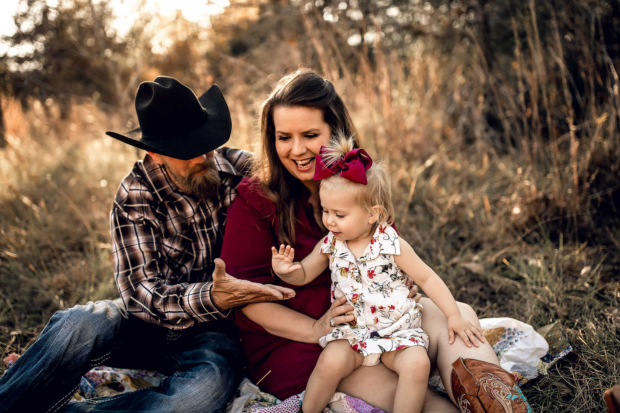 shelby-schiller-photography-family-dad-cowboy-hat-maroon-dress-high-fives.jpg