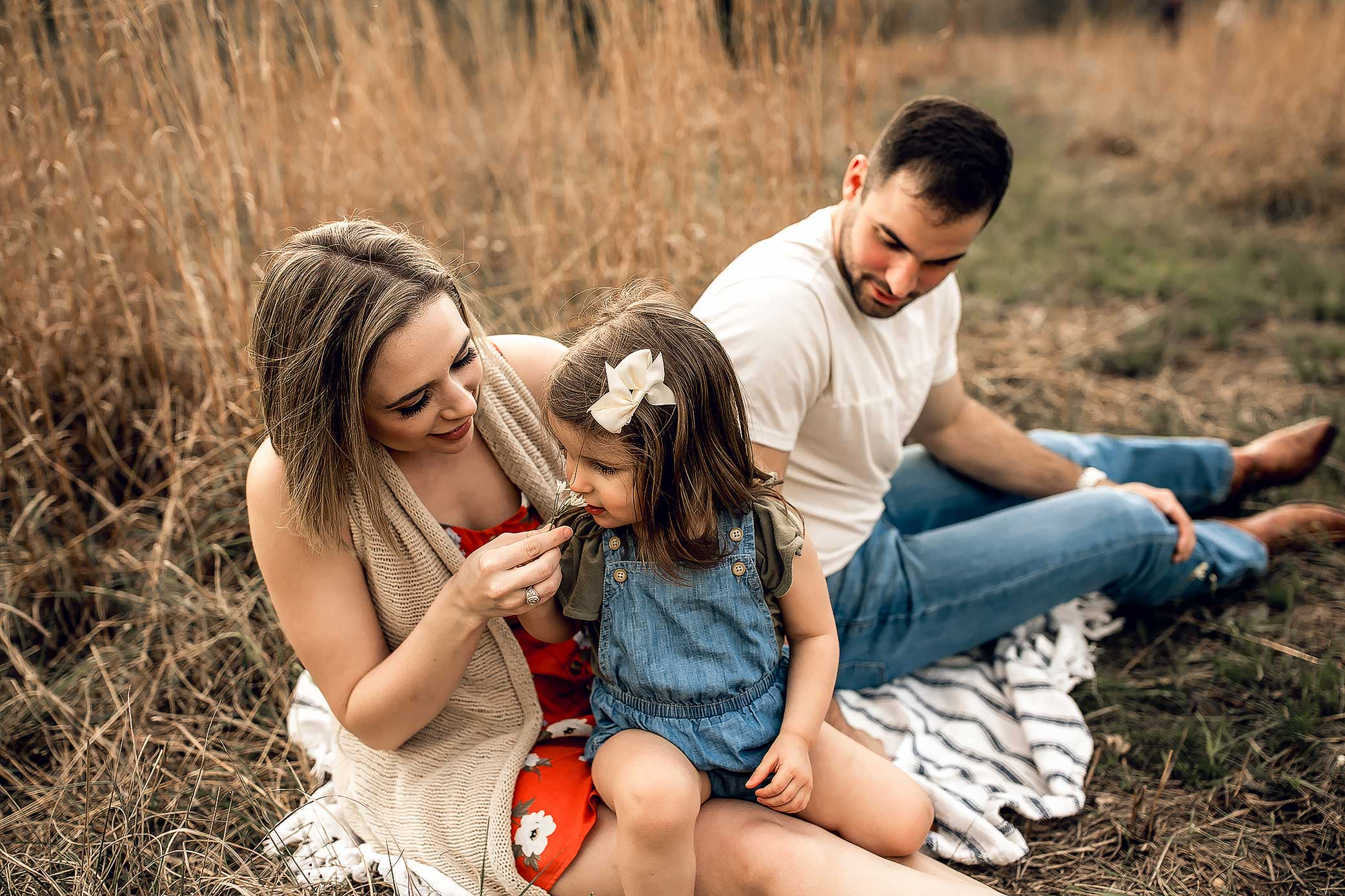 shelby-schiller-photography-family-rust-blue-and-cream-outfits-on-blanket.jpg