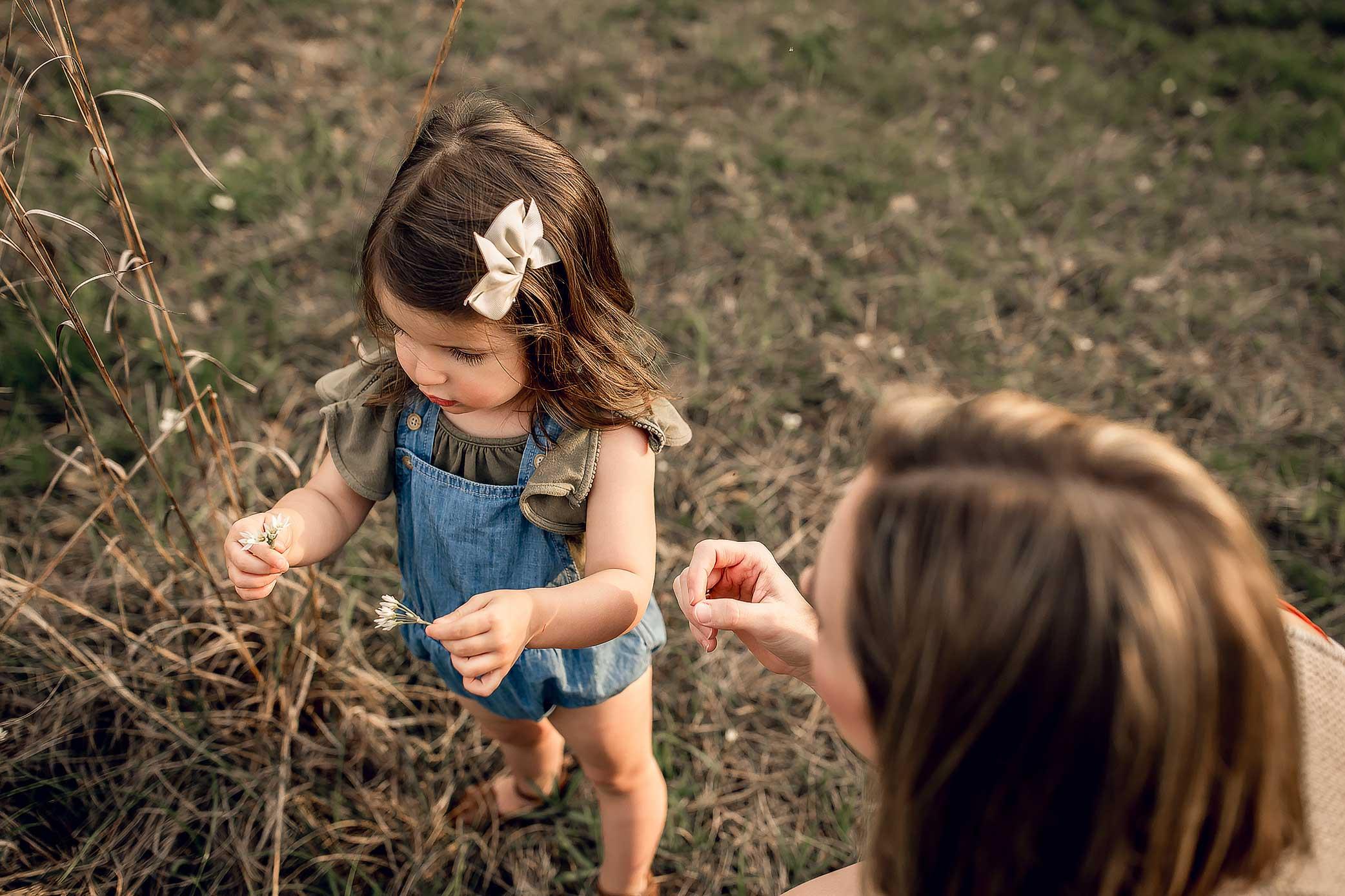 shelby-schiller-photography-family-toddler-in-denim-romper-picking-flowers.jpg