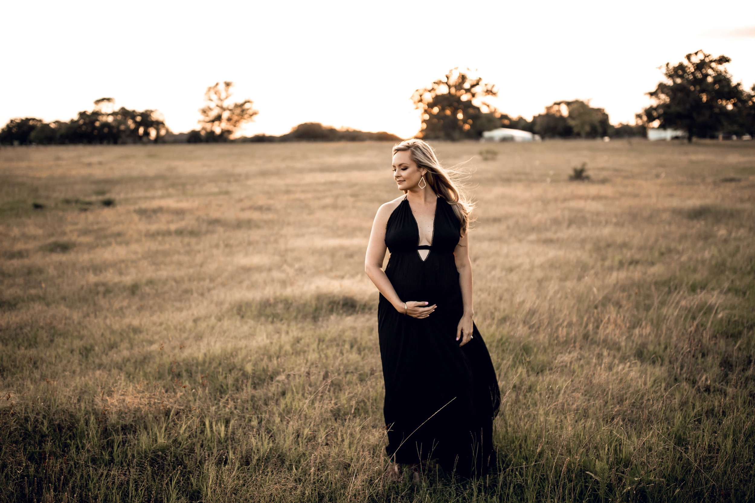 shelby-schiller-photography-maternity-deep-v-black-dress-in-field-at-sunset.jpg