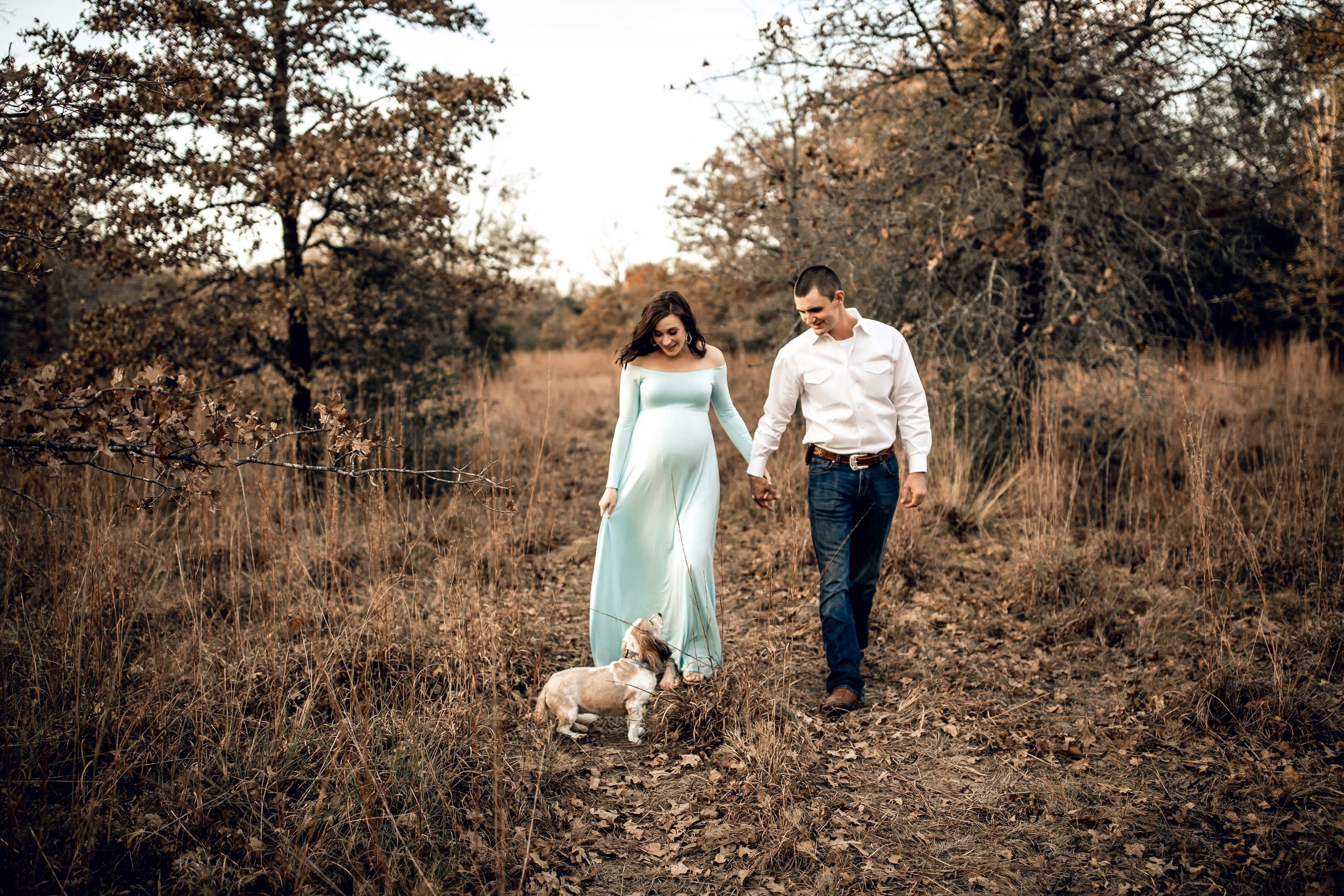 shelby-schiller-photography-maternity-walking-holding-hands-with-dog.jpg