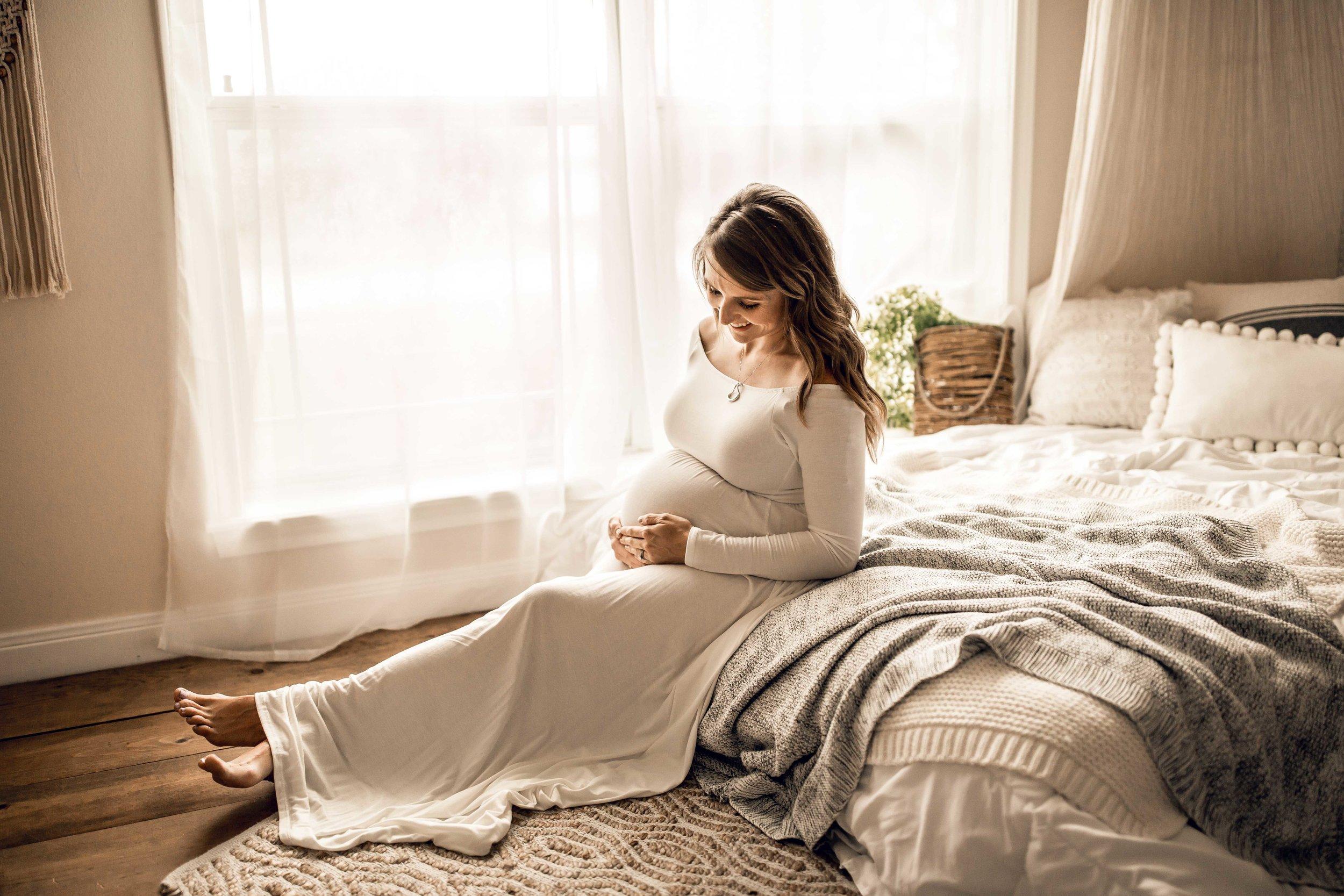 shelby-schiller-photography-maternity-white-flowy-dress-cream-gray-wood.jpg