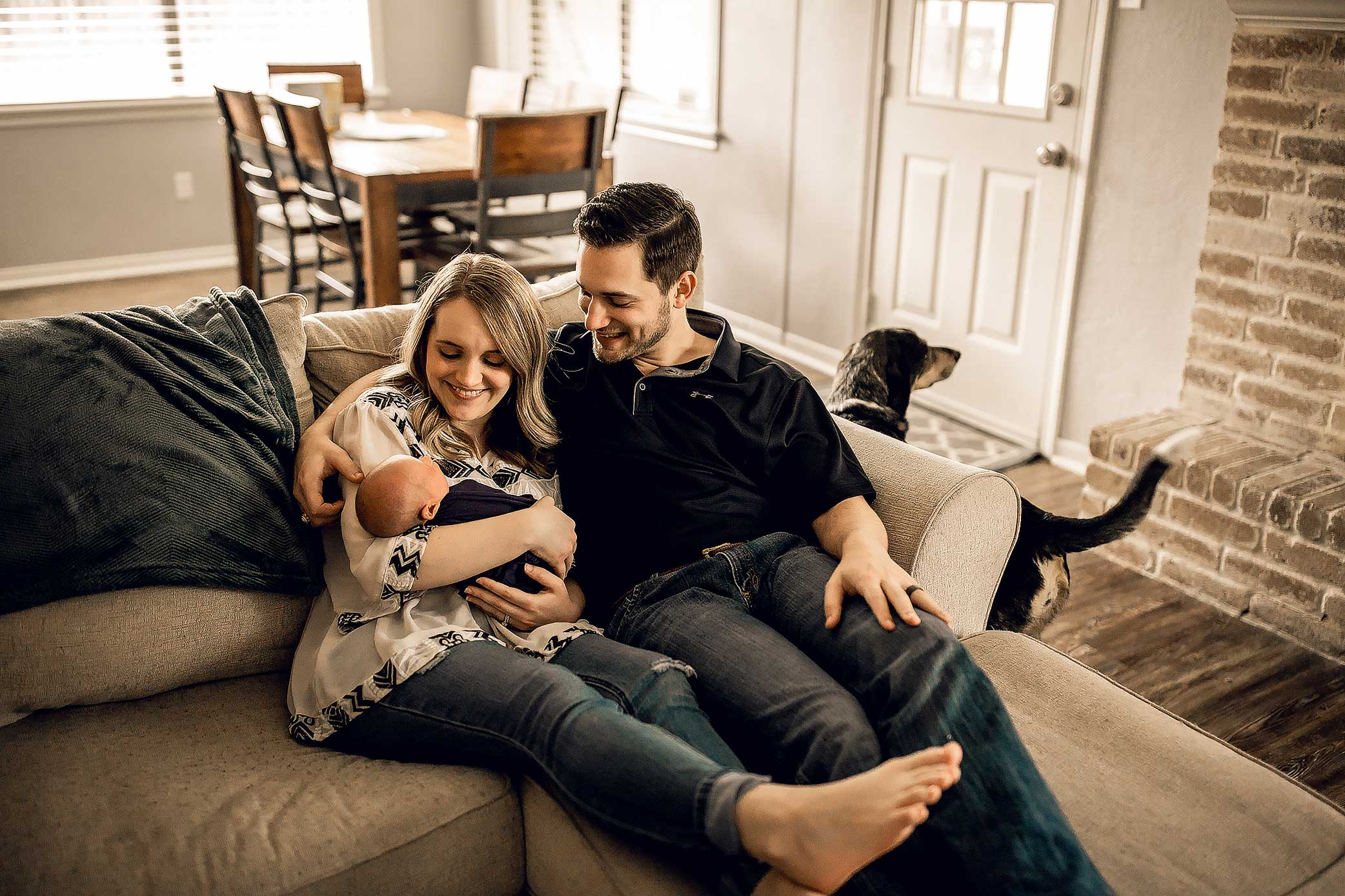 shelby-schiller-photography-lifestyle-newborn-lounging-on-couch-with-dog-included.jpg