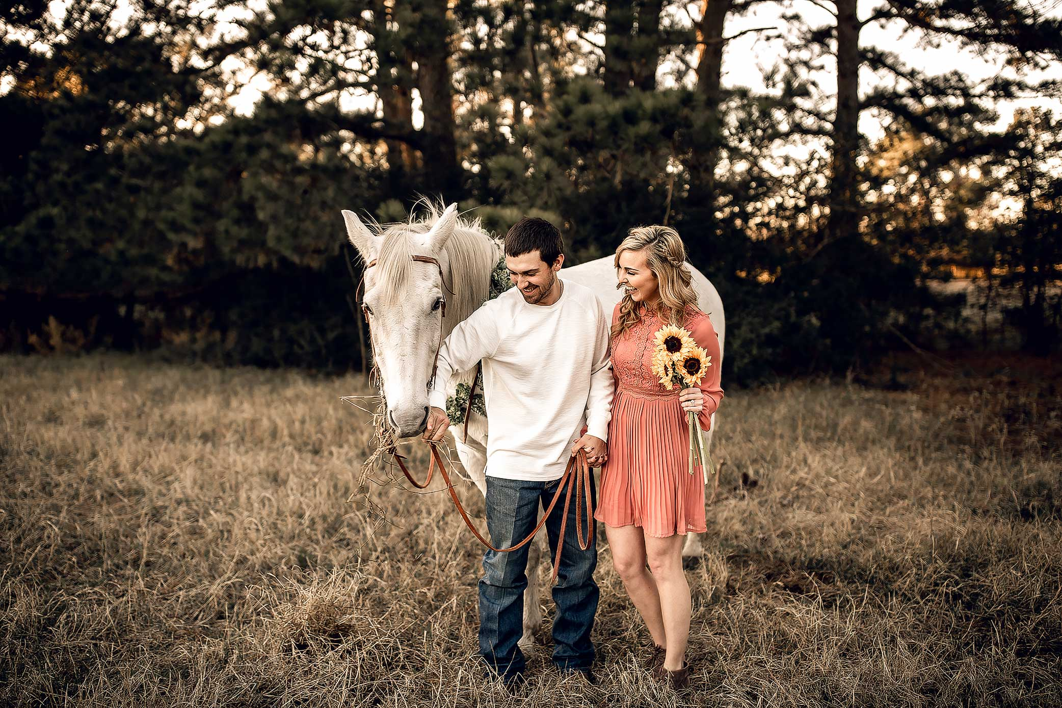 shelby-schiller-photography-couples-outdoor-with-boho-horse-and-rust-colored-dress.jpg