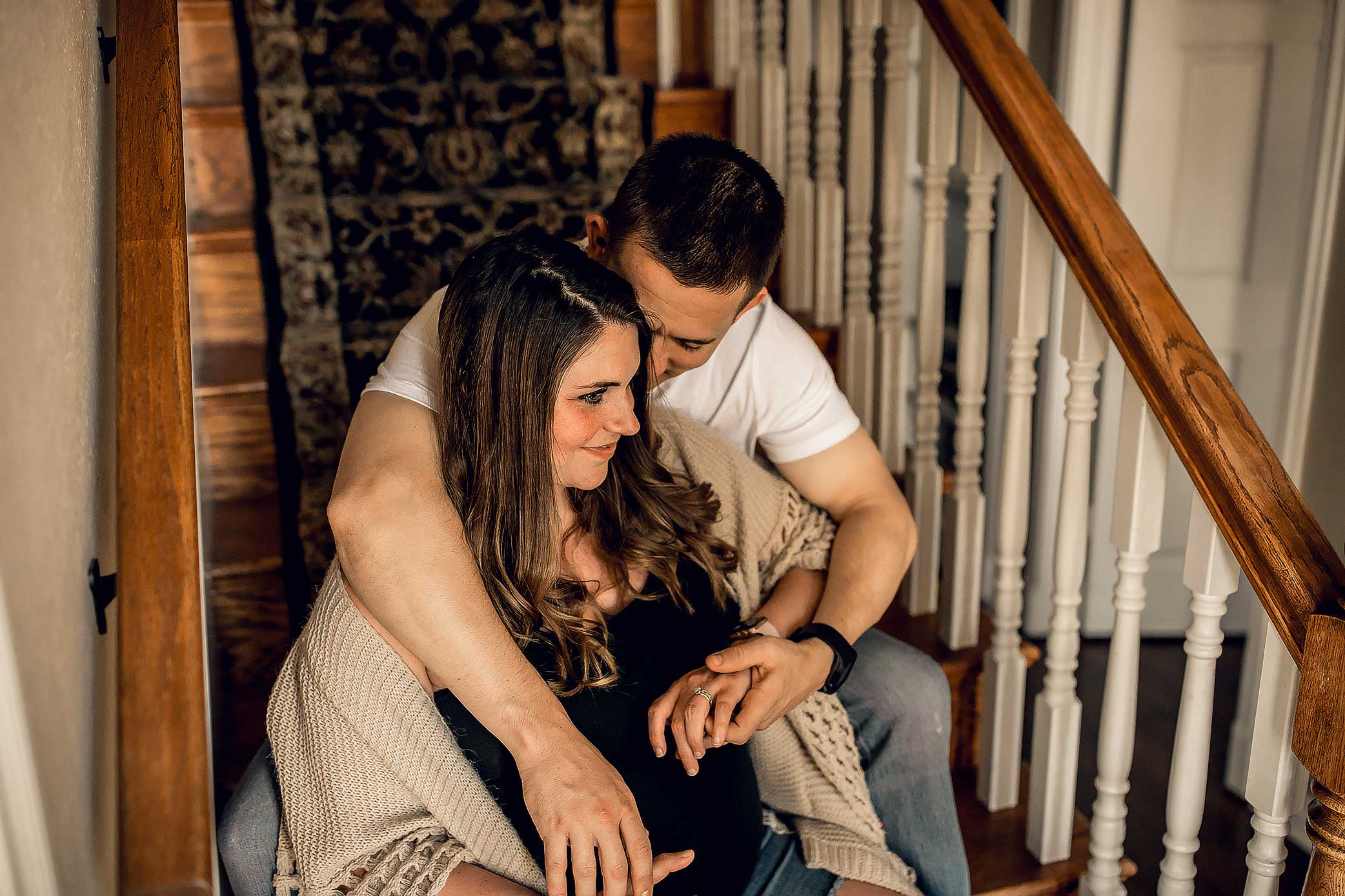 shelby-schiller-photography-couples-snuggled-up-on-stairway.jpg
